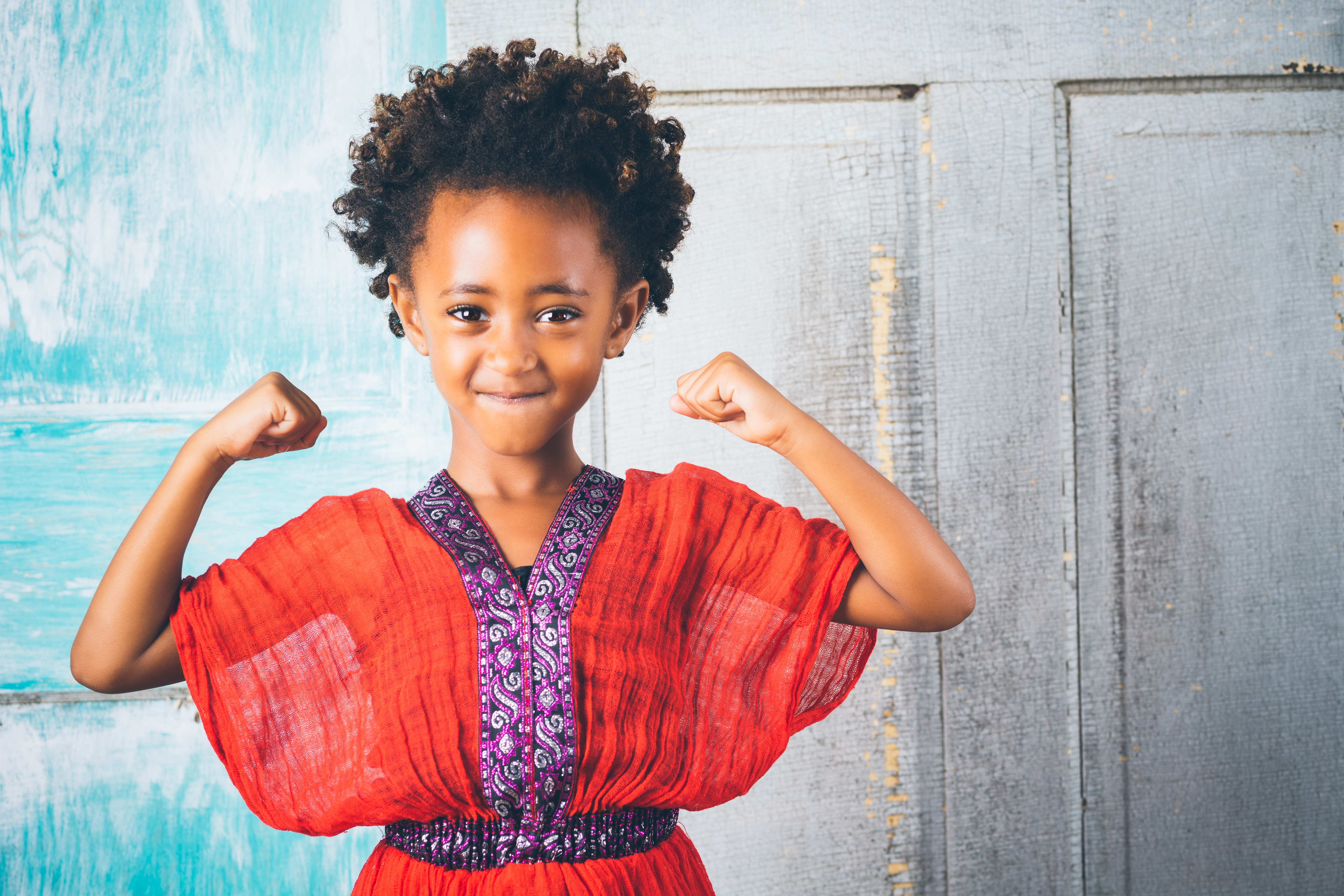 Beautiful young Ethiopian girl in traditional clothing, showing strength
